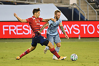KANSAS CITY, KS - SEPTEMBER 02: Johnny Russell #7 of Sporting Kansas City holds off Ryan Hollingshead #12 of FC Dallas during a game between FC Dallas and Sporting Kansas City at Children's Mercy Park on September 02, 2020 in Kansas City, Kansas.