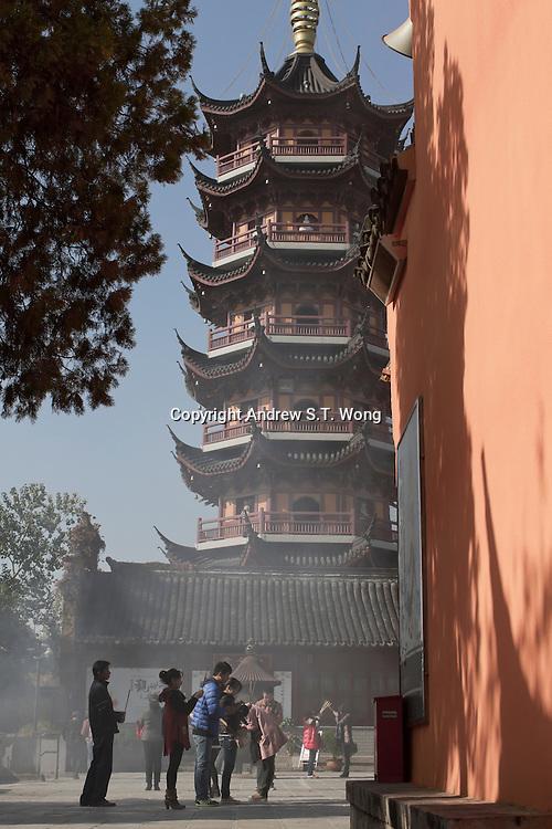 Buddhists pray and offer incense at Jiming Temple in Nanjing, Jiangsu province, China, November 2012.