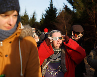 Member of the neo-pagan Asatru association watching the solar eclipse  in Reykjavik, Iceland.