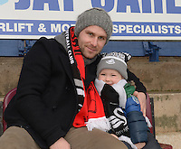Burnley v Swansea <br /> Tony Carmichael with his son Reece aged 3  who was attending his first football match