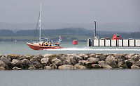 BNPS.co.uk (01202) 558833. <br /> Pic: BNPS<br /> <br /> Pictured: A RNLI lifeboat leaving Poole Quay, Dorset. <br /> <br /> The search for a heroic teenager who is feared to have drowned after rescuing his nieces and nephews from a ferocious riptide is continuing today.<br /> <br /> Callum Osborne-Ward, 18, was swept away in front of his family moments after lifting the last of a group of children into a rescue boat.<br /> <br /> The youngsters had been swimming and playing in relatively shallow water close to Black Bridge at Rockley Point in Poole Harbour, Dorset, when they were dragged away by the fast flowing tide.