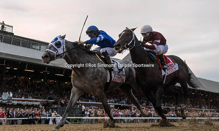 August 28, 2021: Essential Quality #2, ridden by jockey Luis Saez holds off a stubborn Midnight Bourbon #1 ridden by jockey Ricardo Santana Junior to win the Grade 1 Travers Stakes at Saratoga Race Course in Saratoga Springs, N.Y. on August 28th, 2021. Rob Simmons/Eclipse Sportswire/CSM