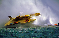 """The Grand Prix Hydroplane """"Wild Fire"""" ( # GP-12 ) driven by George Stratton dives through the roostertail of another boat and begins to flip over. The boat would do a 360 degree barrel-roll and come to rest upright with the hull and driver in fine conditition...© F. Peirce Williams 1998"""
