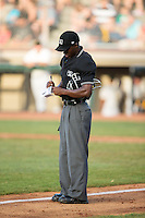 Home plate umpire Darrell Roberts between innings of the Appalachian League game between the Burlington Royals and the Bristol Pirates at Boyce Cox Field on July 10, 2015 in Bristol, Virginia.  The Pirates defeated the Royals 9-4. (Brian Westerholt/Four Seam Images)