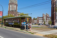 New Orleans, Louisiana.  St. Charles Street Trolley Stopping in front of Loyola University Campus.  Uptown District.