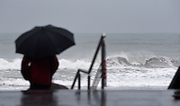 A picture taken on February 10, 2016 shows waves hitting the Basque village of Zarautz. Alerts have been issued for dangerous waves along the Basque coast. PHOTO/ ANDER GILLENEA
