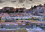 Sunset casts the ruins of the Roman Imperial Fora (the Forum of Caesar) in stark relief.  View from the Via dei Fori Imperiali in Rome, Italy.  (HDR image)
