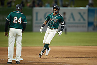 Lolo Sanchez (34) of the Greensboro Grasshoppers rounds the bases after hitting a walk-off 2-run home run against the Hickory Crawdads at First National Bank Field on May 6, 2021 in Greensboro, North Carolina. (Brian Westerholt/Four Seam Images)