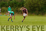 Dilan Ó Donnchú for Piarsaigh na Dromoda evades several tackles from Milltown/Castlemaine and finishes with a point.