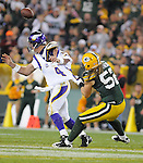 Green Bay Packers linebacker Clay Matthews attacks Minnesota Vikings quarterback Brett Fsvre during the 4th quarter of the game at Lambeau Field in Green Bay, Wis., on Oct. 24, 2010.