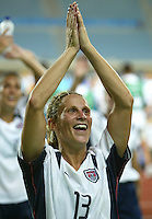 23 August 2004:   Kristine Lilly celebrates with the USA fans after USA defeated Germany in overtime during the semifinal game at Pankritio Stadium in Heraklio, Greece.     USA defeated Germany, 2-1 in overtime,  .   Credit: Michael Pimentel / ISI