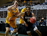 SIOUX FALLS, SD - MARCH 9: Kareem Thompson #2 of the Oral Roberts Golden Eagles drives against a pair of defenders including Rocky Kreuser #34 of the North Dakota State Bison during the 2021 Men's Summit League Basketball Championship at the Sanford Pentagon in Sioux Falls, SD. (Photo by Dave Eggen/Inertia)