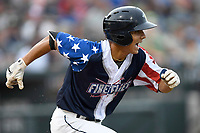 Shortstop Andres Gimenez (13) of the Columbia Fireflies runs out a batted ball in a game against the Rome Braves on Monday, July 3, 2017, at Spirit Communications Park in Columbia, South Carolina. Columbia won, 1-0. (Tom Priddy/Four Seam Images)