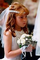 File, Montreal (Quebec) CANADA<br /> Model released photo of a little red hair girl  hoding the flower bouquet during a wedding<br /> Jeune fille rousse tenant le bouquet de fleurs durant un mariage <br /> Photo (c)  Pierre Roussel/ Images Distribution