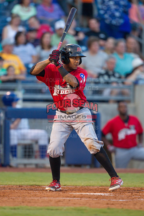 Frisco RoughRiders left fielder Teodoro Martinez (28) waits for a pitch at the plate during the Texas League game against the Tulsa Drillers at ONEOK field on August 15, 2014 in Tulsa, Oklahoma  The RoughRiders defeated the Drillers 8-2.  (William Purnell/Four Seam Images)