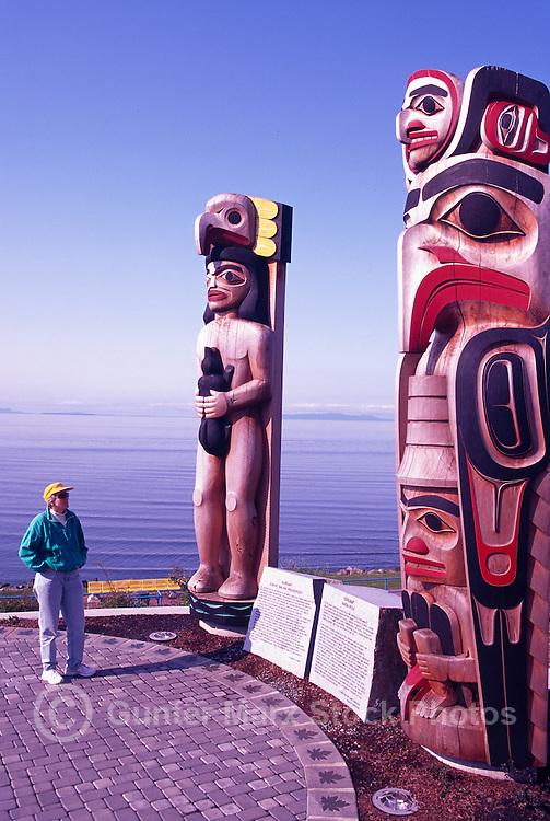 White Rock, BC, British Columbia, Canada - Coast Salish and Haida Totem Poles in Lions Park, along Seaside Promenade Walkway and Semiahmoo Bay (Model Released)