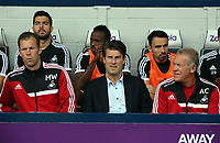 Pictured L-R: Swansea assistant manager Morten Wieghorst, manager Michael Laudrup and first team head coach Alan Curtis. Sunday 01 September 2013<br /> Re: Barclay's Premier League, West Bromwich Albion v Swansea City FC at The Hawthorns, Birmingham, UK.