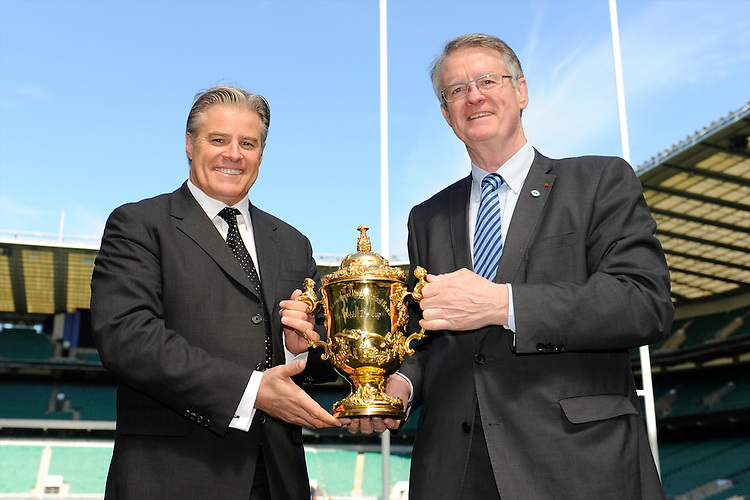(L-R) IRB CEO and RWCL Managing Director Brett Gosper and IRB and RWCL Chairman Bernard Lapasset with the Webb Ellis Trophy  during the Rugby World Cup 2015 Venues and Match Schedule Launch at Twickenham Stadium on Thursday 2nd May 2013 (Photo by Rob Munro)