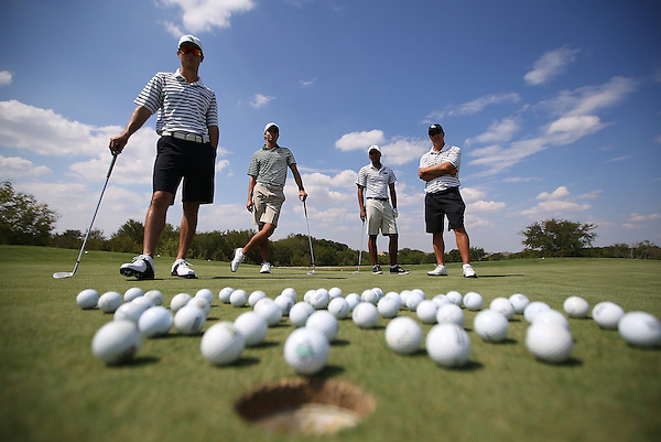 SOUTHLAKE, TX - SEPTEMBER 10: North Texas Mean Green Men's Golf team on the green at the Trophy Club Country Club in Southlake on September 10, 2013 in Southlake, Texas. Photo by Rick Yeatts