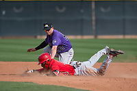 Colorado Rockies second baseman Bret Boswell (90) applies a tag to Jose Verrier (74) during a Minor League Spring Training game against the Los Angeles Angels at Tempe Diablo Stadium Complex on March 18, 2018 in Tempe, Arizona. (Zachary Lucy/Four Seam Images)