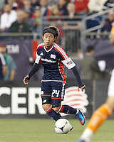 New England Revolution midfielder Lee Nguyen (24) brings the ball forward. In a Major League Soccer (MLS) match, the New England Revolution tied Houston Dynamo, 2-2, at Gillette Stadium on May 19, 2012.