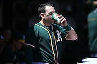 OAKLAND, CA - MAY 29:  Nick Punto of the Oakland Athletics drinks Gatorade in the dugout during the game against the Detroit Tigers at O.co Coliseum on Thursday, May 29, 2014 in Oakland, California. Photo by Brad Mangin