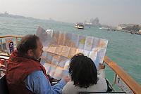 - Venice, tourists on a public transport boat....- Venezia, turisti a bordo di un battello per il trasporto pubblico