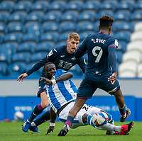 20th February 2021; The John Smiths Stadium, Huddersfield, Yorkshire, England; English Football League Championship Football, Huddersfield Town versus Swansea City; Mouhamadou-Naby Sarr of Huddersfield Town tackles on the floor against Jamal Lowe of Swansea City