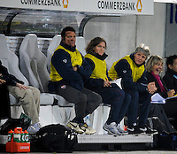 Pia Sundhage and trainers on the bench. US Women's National Team defeated Germany 1-0 at Impuls Arena in Augsburg, Germany on October 29, 2009.