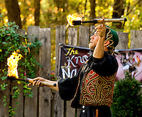 A costumed performer entertains with fire at the annual Carolina Renaissance Festival in November 2011. The annual Renaissance Festival and Fair takes place each October and November in Huntersville, NC, near Charlotte, NC.