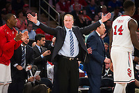 NEW YORK, NY - Sunday December 13, 2015: St. John's University Head Coach Chris Mullin makes gestures on the sidelines.  The St. John's Red Storms takes on the Syracuse Orangemen during the NCAA men's basketball regular season at Madison Square Garden in New York City.