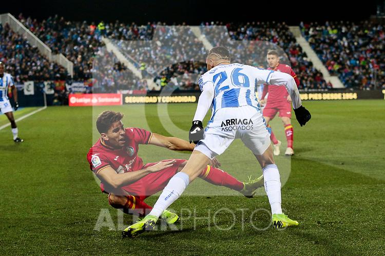 CD Leganes' Youssef En-Nesyri and Getafe CF's Leandro Cabrera during La Liga match between CD Leganes and Getafe CF at Butarque Stadium in Leganes, Spain. December 07, 2018. (ALTERPHOTOS/A. Perez Meca)