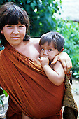 Ipixuna village, Amazon, Brazil. Arawete mother and son with green eyes, traditional hair and cotton cloth. Para State.