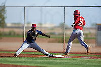 Cleveland Indians Jose Medina (33) stretches for a throw as Zach Shields (21) runs through the bag during an instructional league game against the Cincinnati Reds on October 17, 2015 at the Goodyear Ballpark Complex in Goodyear, Arizona.  (Mike Janes/Four Seam Images)