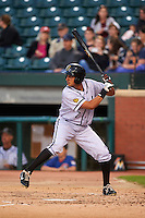 Jacksonville Suns outfielder Carlos Lopez (7) at bat during a game against the Chattanooga Lookouts on April 30, 2015 at AT&T Field in Chattanooga, Tennessee.  Jacksonville defeated Chattanooga 6-4.  (Mike Janes/Four Seam Images)