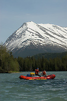Nick Lynch and Kirsten Olsen float the upper Kenai River, with late spring snow still covering the surrounding mountains.