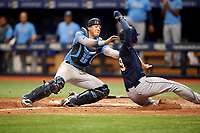 Roberto Alvarez (17) tags Beau Brundage (19) as he slides home during the Tampa Bay Rays Instructional League Intrasquad World Series game on October 3, 2018 at the Tropicana Field in St. Petersburg, Florida.  (Mike Janes/Four Seam Images)