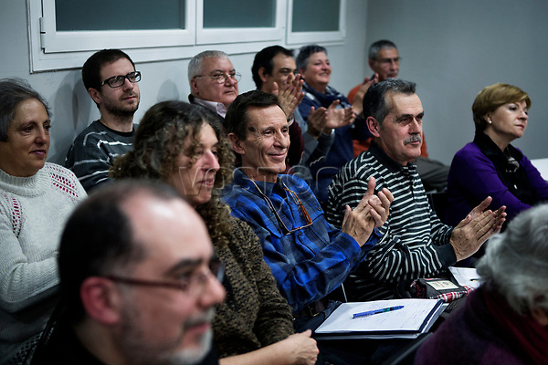 Madrid, Spain, February 12, 2015. Members of the left wing [party] Podemos acclaim a comrade during their weekly meeting in Salamanca's neighbourhood in Madrid.