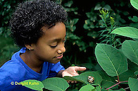 1Y08-098z  Minority Child with Western Garden Snail.