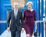 © Joel Goodman - 07973 332324 . 05/10/2016 . Birmingham , UK . THERESA MAY and PHILIP BALL cross from the Hyatt Hotel to the Conference centre ahead of Theresa May delivering the leader's speech at the close of the conference . The fourth and final day of the Conservative Party Conference at the International Convention Centre in Birmingham . Photo credit : Joel Goodman