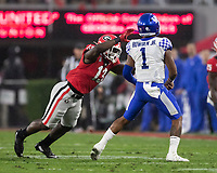 ATHENS, GA - OCTOBER 19: Azeez Ojulari #13 of the Georgia Bulldogs pressures Lynn Bowden Jr. #1 of the Kentucky Wildcats who throws the ball out of bounds during a game between University of Kentucky Wildcats and University of Georgia Bulldogs at Sanford Stadium on October 19, 2019 in Athens, Georgia.