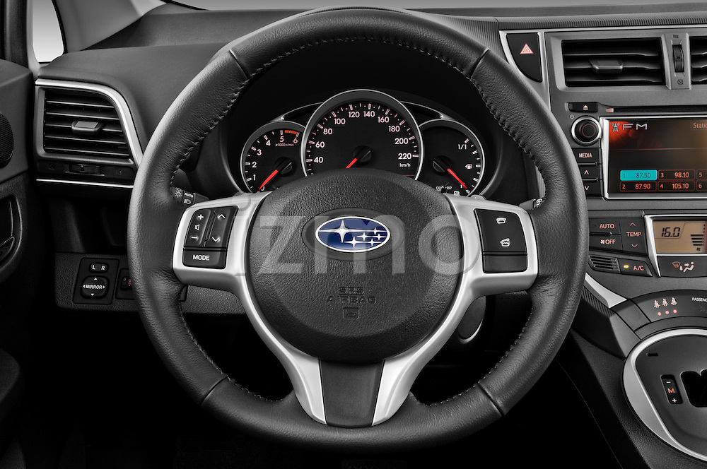 Steering wheel view of a 2011 Subaru Trezia Comfort 5 Door Hatchback