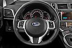 Steering wheel view of a 2011 Subaru Trezia Comfort 5 Door Hatchback