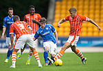 St Johnstone v Blackpool...25.07.15  McDiarmid Park, Perth.. Pre-Season Friendly<br /> Craig Thomson is closed down by Brad Potts and David Ferguson<br /> Picture by Graeme Hart.<br /> Copyright Perthshire Picture Agency<br /> Tel: 01738 623350  Mobile: 07990 594431