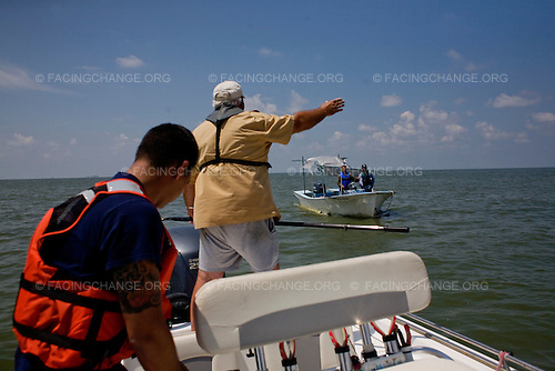 Barrier Islands off Venice, Louisiana.June 15, 2010..Anti-oil boom maintenance. The booms have to be constantly attended because of tides, weather, and saturation with oil. Initial booming was only partially successful. BP Deepwater Horizon oil spill..