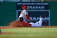 Batavia Muckdogs J.D. Orr (22) slides safely into second base as shortstop Jose Sanchez (44) fields the throw during a NY-Penn League game against the Auburn Doubledays on June 18, 2019 at Dwyer Stadium in Batavia, New York.  Batavia defeated Auburn 7-5.  (Mike Janes/Four Seam Images)