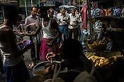 Vendors prepare food at stalls in Kolkata, West Bengal, India.