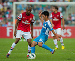 Vassirkiri Abou Diaby of Arsenal FC and Lam Ka Wai of Kitchee in action during the pre-season Asian Tour friendly match at the Hong Kong Stadium on July 29, 2012. Photo by Victor Fraile / The Power of Sport Images