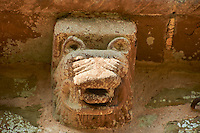 Norman Romanesque exterior corbel no 12 - sculpture of the head of an animal with a lions mane and big fanged teeth. The Norman Romanesque Church of St Mary and St David, Kilpeck Herefordshire, England. Built around 1140
