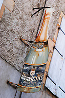 Tasting Blanquette de Limoux Tournie & Fils. Town of Limoux. Limoux. Languedoc. Rusty old promotional sign. France. Europe. Bottle.